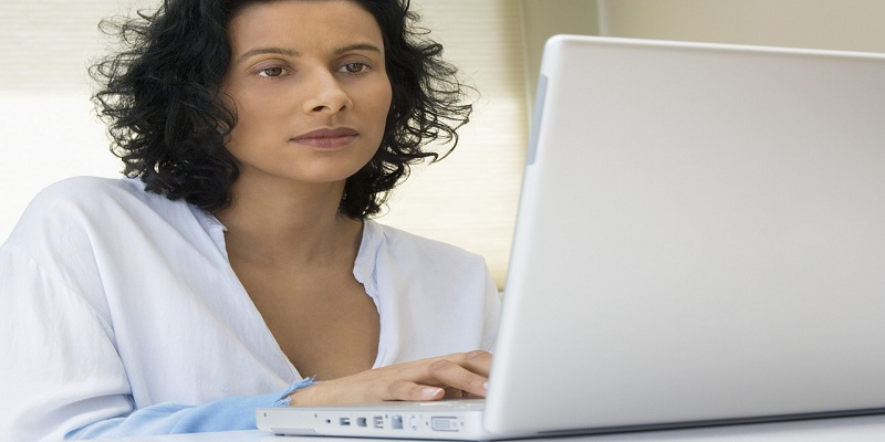 Woman Using Laptop --- Image by © Royalty-Free/Corbis
