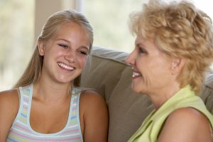 mother-and-teenage-daughter-talking-happy